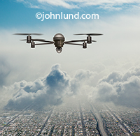 Pictures of a drone flying in the sky. In this stock photo a single drone flies through the clouds high above a city below in an image perfect for illustrating communications around drones and the issues that accompany them.