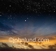 Stars at dawn in a sky that transitions from night to sunrise is seen in this dynamic stock photo about new beginnings.