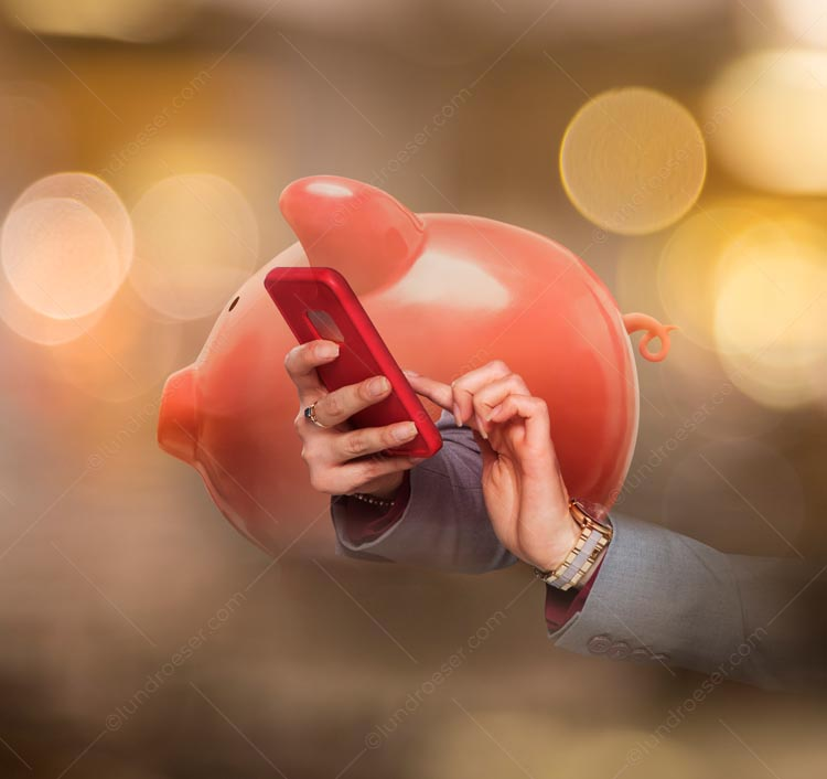 Ecommerce and online mobile banking are seen in this stock photo of a piggy bank superimposed over a woman's hands using a smartphone.