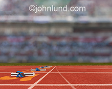 Empty starting blocks on an outdoor track are featured in this stock photo about preparation, competition, and opportunity.