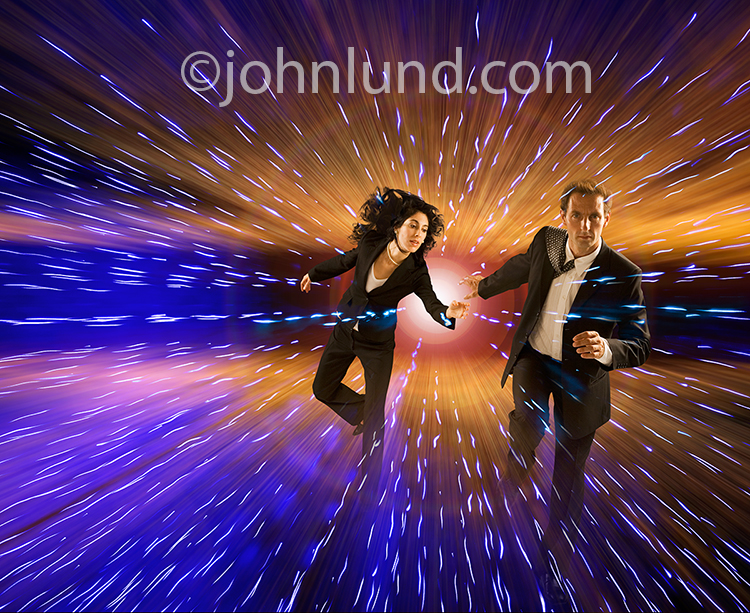 A couple runs through a surrealistic background of streaming light trails in a stock photo about escape from technology, escape from digital, and running from big data.