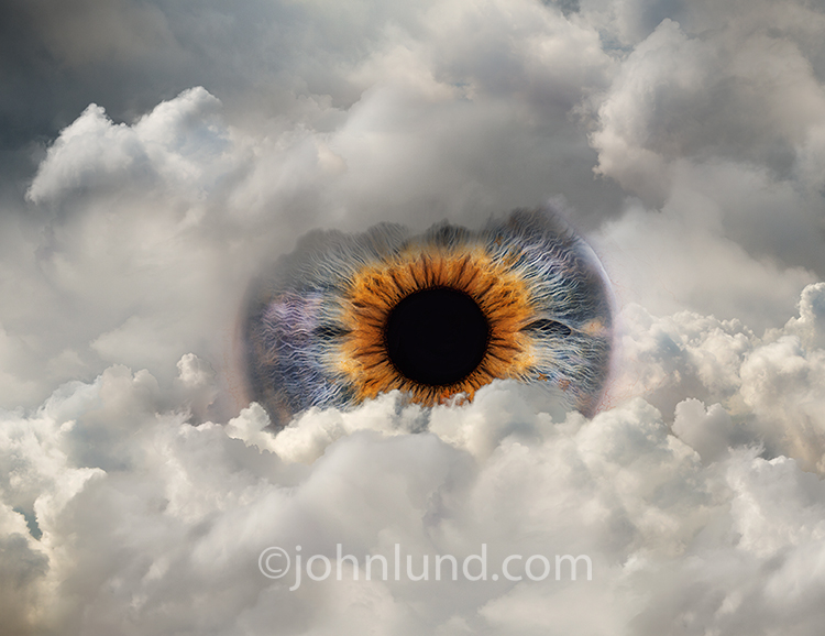 A giant eye peeks out through a cloud bank in a stock photo about surveillance and security issues online and in the cloud.