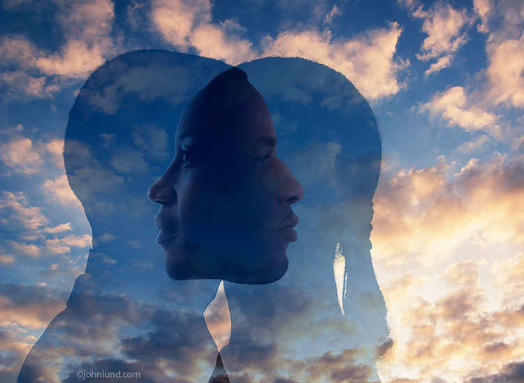 Two semi-transparent people overlap against a brilliant sunrise creating an image of faces looking within in a unique and thought-provoking image about introspection, relationships and even the paranormal.