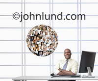 Photo of a businessman next to a sphere of photos: His social and business networking world via facebook, linked in and other social Internet sites.