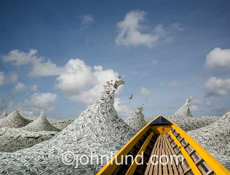 A financial journey is indicated by this image of a boat navigating through waves of dollars under a summer sky dotted with white clouds, an image that can illustrate finanical planning, retirement planning, and investment.