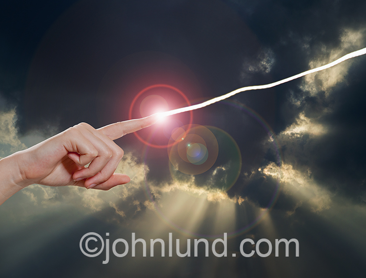 A finger shoots out a bolt of light against a God Ray background in an image about spirituality, connections, and future communications.