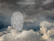 Within a cloudscape is a formation of smaller clouds forming the unmistakable shape of a fingerprint in a concept photo about security in