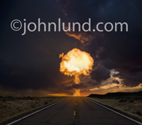 Picture of a mushroom shaped fireball exploding in the distance over a deserted road at dusk in a stock photo about nuclear accidents, risk, danger and calamity.