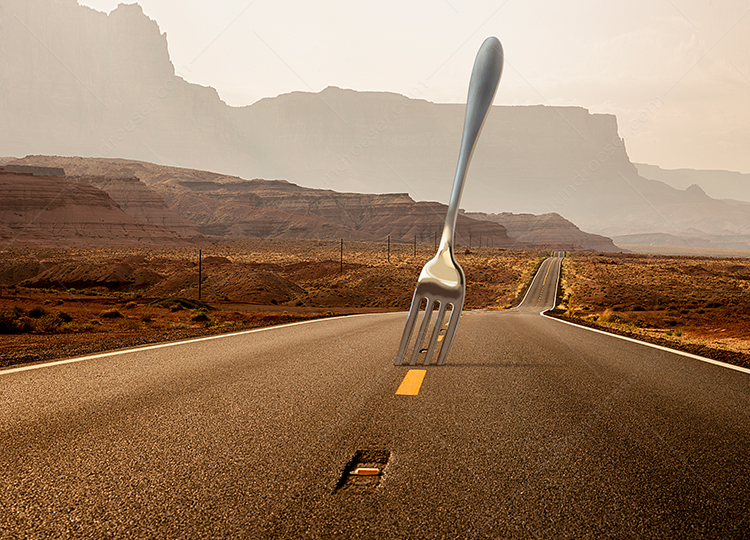 "A giant fork protrudes from a long empty road,  a humorous take on the idea of a ""fork in the road"", decisions, journeys, and possibilities."
