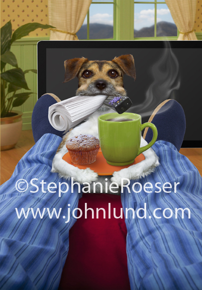 A Jack Russell Terrier stands at the feet of his master with coffee, a newspaper, a muffin and a TV remote.