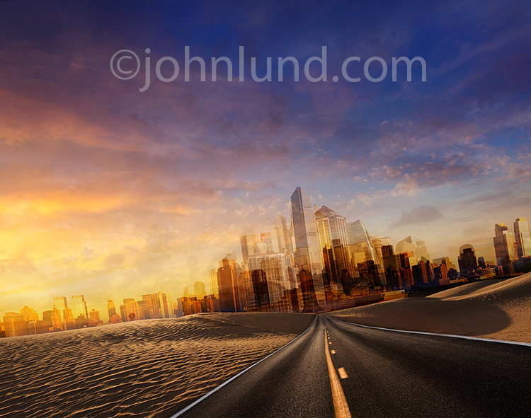 A futuristic city, a golden metropolis, emerges at the end of a long strait road cutting through a desert environment in a photo depicting the way forward and possibilities.