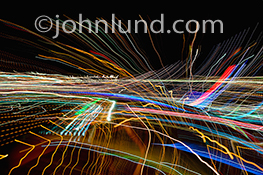 Future networking is the primary concept represented by this image created from streaking colored lights etched across a black bacground in a pattern of dynamic speed and motion.