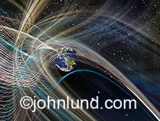 Inter galactic communications and communications technology are illustrated in this stock photo of lines of colored lights intersecting Earth in deep space.
