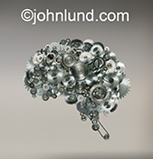 Gears, cogs, wheels and chains take on the shape of a human brain in this stock photo about an active mind, how the brain works, and the mechanics of creativity.