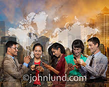 A globally connected group uses their mobile devices to access the world in a stock photo about business teamwork, global connections, and social networking.