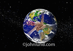 Global teamwork in the form of five hands coming together over the planet earth is seen in this stock photo about success, cooperation, achievement and sealing the deal.