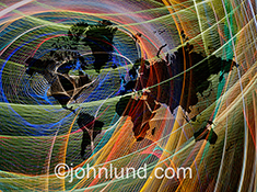 Global connections, wireless communications and international networking are all demonstrated in this colorful and vibrant image of the planet's continents surrounded by dynamic swirls of streaking colored lights.