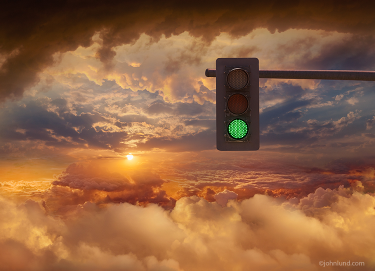 "In a beautiful high altitude cloudscape at sunset a green stoplight indicates it is all ""go"" for cloud computing in this concept stock photo about online computing, networks and ""The Cloud""."