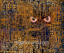 Hacking is portrayed in this stock photo of a pair of evil eyes peering out from a complex network of computer circuitry.