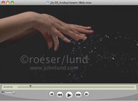 A woman's hands are seen shaking or flicking the water off in a slow motion stock video clip.