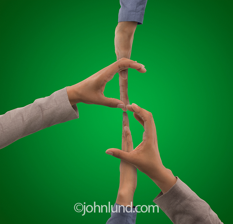 Four hands come together to form a dollar sign against a currency-green background in an image about finance, investment and money issues.