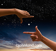 Exploration and possibilities are just two of the concepts illustrated by this image of a pair of hands framing a star filled night sky in a concept stock photo.