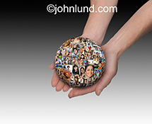 A pair of hands cradle a globe of people's portraits in a social media stock photo about connection, opportunity and networking.