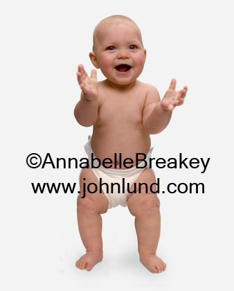 Angry looking baby picture. This looks like one mean little baby. Hes ready to take anyone on. The ticked off little guy is wearing a diaper and standing in a fighting pose. Bald baby pics. Funny baby picture.