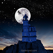 A haunted house stands silhouetted against a full moon as a witch flies overhead on her broomstick in a humorous greeting card and stock photo image.