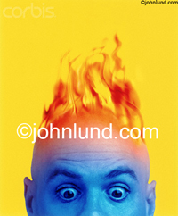 Picture of a man's head on fire while his face turns blue: Extreme emotions expressed from surprise to excitement to astonishment. A bald man has flames leaping up from his scalp set against a yellow background. This guy is all fired up.