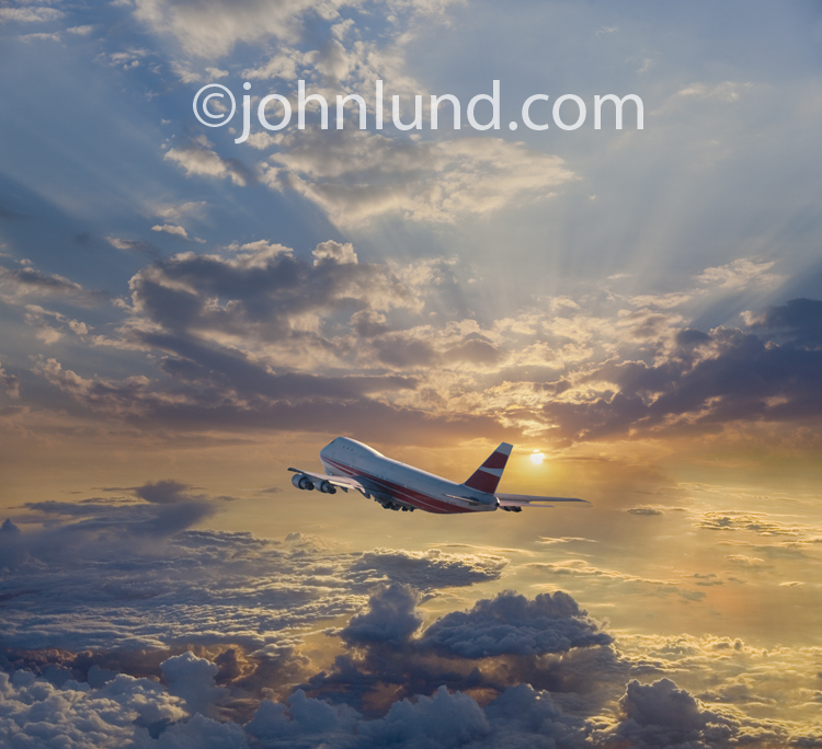 A jumbo jet flies over a breath-taking sunrise or sunset at high altitude in this photo about journeys and vacations.