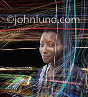 Portrait of an African American business executive in an environment of high tech light patterns indicating tech development.
