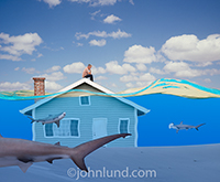 In this photo of a home under water and with sharks swimming by, the clear message is that of mortgages in trouble, home loan defaults, and mortgage lending problems and issues.