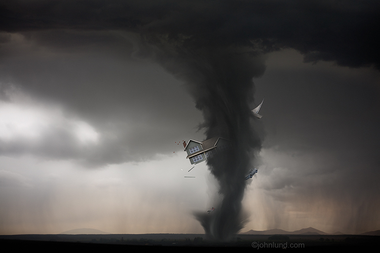 A tornado, or twister, is  carrying a house, a boat, a car and a motorcycle in it's funnel cloud in a stock photo about insurance issues, disaster, and violent, stormy weather.