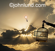 Ideas set free and unrestricted imagination are indicated in this image that shows a light bulb rising up into a god ray sky out of a bird cage, it's door hanging open.