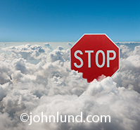 This image of a stop sign emerging from the clouds is a metaphor for the need for caution in using the cloud and an opportunity for advertisers to deliver their messages about the products and services they provide to help insure success in