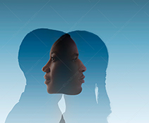 An introspective couple, this stock photo features a hetersexual couple with overlapping silhouettes resulting in faces looking within and into the other in an image about relationships and introspection.