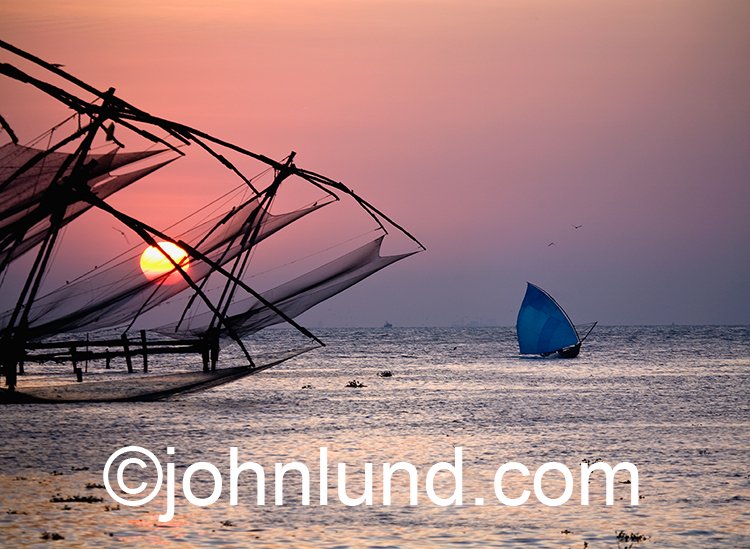 Fishing nets at sunset are featured in this stock photo shot in Keral, India.
