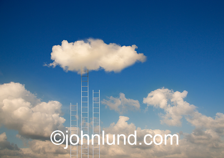 Cloud computing access is the theme behind this stock photo of ladders leading up to clouds.