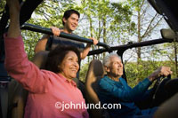Stock photo of a Mexican family driving their jeep while four wheeling in the woods. Happy family fun pictures during leisure and adventure while on a camping vacation in the wilderness. Hispanic family trip pics for ads.