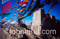 Travel and adventure stock photo of Tibetan prayer flags high atop a Himalayan Moutain against a clear deep blue sky.Ladakh is a geo-political region in the himalayan Mountains in India. Ladakh borders Pakistan and Tibet.
