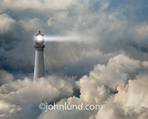 A lighthouse casts its beam out through fog and clouds in a photo about guidance, security and risk that can be applied to everything from navigating the globe to navigating the Internet and cloud computing.