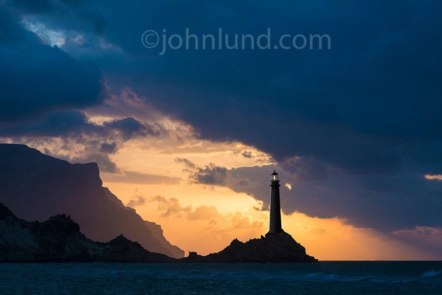Lighthouses make for beautiful photos and this lighthouse, silhouetted against a dramatic sunset sky is breathtaking and elegant.