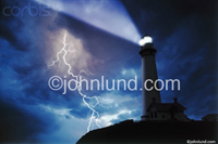 Picture of a lighthouse in a lightning storm set in a dark stormy night with a huge lightning strike bolting down to the ground from the storm clouds above.