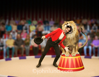 Stock shot of a lion trainer (or tamer) putting his head in a Lion's Mouth representing trust, danger, risk, challenge and, perhaps, foolishness. Lion tamer pics.