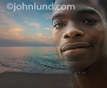 An African American man's face is superimposed over a pre-dawn tropical beach in an image about vacations, getting away from it all, and tropical travel.