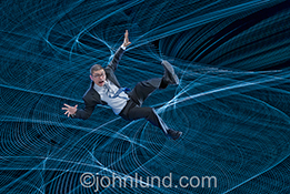 A businessman falls into a cyber safety net in this stock photo about security and safety in the cloud, cloud computing, networking and wireless communications.