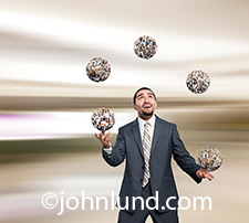 An Hispanic businessman juggles social media in the form of balls or spheres of portraits in an image about administrating and managing social networking in the business arena.