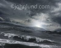 Stormy skies, choppy waves and a lightning strike define this rough seas storm photo.
