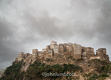An ancient Jewish village in Yemen sits atop a mountain ride as the fog rolls in.